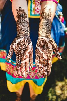 Indian women looks pretty with their traditional attire and mehndi..