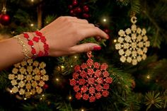 Cruciani AIL Star (in gold), Heart Beat Jewels (in red), Unforgivably Chic (in red) and Happy (in red), Christmas decorations (in red and gold)