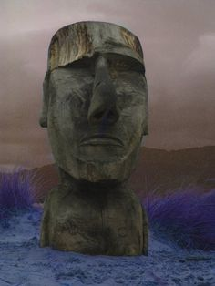 Easter Island Head looking out to sea, Barmouth Beach North Wales  This guy on the dunes always reminds me of the Easter Island head in Night at the Museum... Give me gum - dum dum!