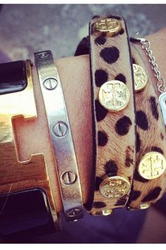 tory burch, cartier & hermes cuffs. I could afford the Tory burch. But would rather have the Cartier :)