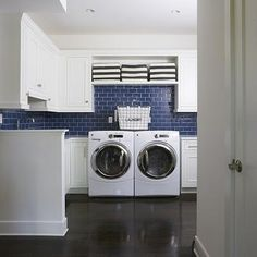 Lovely small laundry room features wire baskets with household goods atop side by side cabinets accented with raised panel doors suspended over a gray washer and dryer. Description from decorpad.com. I searched for this on bing.com/images
