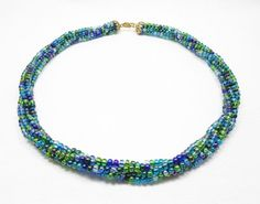 "This 19"" necklace is made with Size 6 Blue and Green Seed Beads.  Pattern: Kumihimo  Kumihimo is a form of Japanese braid-making. This jewelry was made by weaving 8 strands of beads.  I gladly accept"