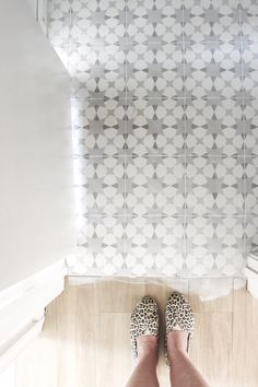 @_teamwayne of S + A INVEST | DESIGN are are to pursue financial freedom by creating beautiful spaces! Their current flip house sports grey and white mosaic tile, light brown wood look tile, a hexagon kitchen backsplash, and more hexagon porcelain tile in the bathroom!