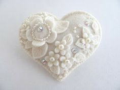 Made from felt and faux pearls and beads -- would make a nice ornament - like the monochromatic look