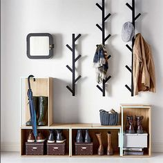 Avoid entryway clutter with open storage boxes for shoes and racks for hats and . Avoid entryway clutter with open storage boxes for shoes and racks for hats and jackets. Ikea Tjusig, Ikea Catalogue 2016, Diy Coat Rack, Coat Racks, Clothes Hanger, Tree Coat Rack, Coat Tree, Hanging Clothes, Home Organization
