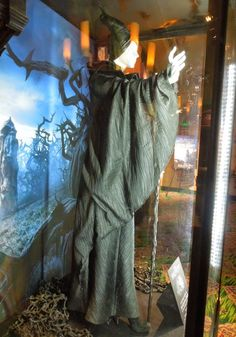 Hollywood Movie Costumes and Props: Angelina Jolie's Maleficent Christening curse movie costume on display... Original film costumes and pro...