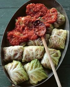 This recipe brings an old family favorite into the 21st century. Savoy cabbage becomes a wrapper for a fragrant mix of beef, pork, herbs, and nutty brown rice. The bundles, which meld with a spicy tomato sauce, are easy to make: The cabbage leaves are boiled briefly until tender and pliable, and then folded around the filling.