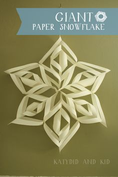 Make a GIANT Paper Snowflake (Tutorial @Kathleen Walck ) I saw these in the Airport! They are cool.