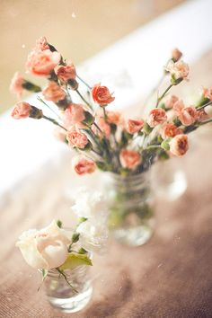 put flowers in a mason jar for a #rustic feel at your #wedding