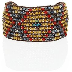 Chunky cuffs add chic touches to every outfit, just like this Nakamol tribal piece. ($43)