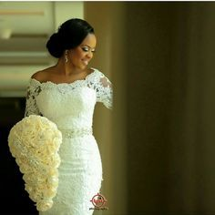 I Do Ghana   Gorgeous bride with a beautiful cascading rose bouquet by swalebridals   Photography by Lypix