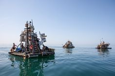 Ramshackle art boats; by Swoon