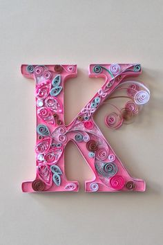 """Quilled letter """"K"""" of Kristen , 6 x 6 free standing , colors are pink , green and brown.https://www.etsy.com/shop/QuillingKimStarcher"""