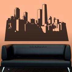 """Vinilo decorativo de una silueta contorno de una ciudad, posiblemente Nueva York. Por la iluminación de los edificios deducimos que es un amanecer o atardecer. Los vinilos skyline, son ideales para oficinas o lugares en los que pretendemos dar un toque urbanita a nuestra decoración de interiores. Combínalo con nuestro vinilo """"Almuerzo en Rascacielos"""" #teleadhesivo #decoracion"""