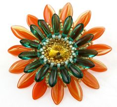 I had the opportunity lately to make a Gerbera daisy, as seen in many bead blogs. I had one rivoli on hand, and it turns out that brandy is a perfect color for a flower center, especially when fram...