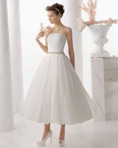Vestidos de novia midi: La propuesta retro que le dará estilo a tu look Image: 2