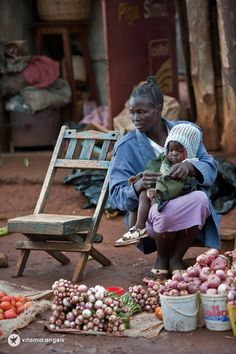 This women is trying to make money buy selling vegetables. This is one common way Africans make a little profit out of what they have.