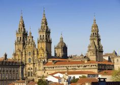 In northwestern Spain, Santiago de Compostela is the capital of Galicia. The oldest part of the town is completely dominated by Romanesque, Gothic and Baroque styles of design. The area also produced the first guide book in the world in the 12th century; the Codex Calixtinus was created to offer guidance to pilgrims. It outlined the route that was most followed which is the Camino de Santiago and its many historical buildings on the way.