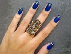 Blue nails with gold stripes
