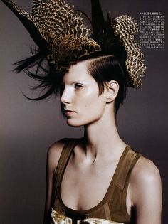 vogue japan  - model: Iris Strubegger, feather's and hairstyles - vogue magazine, short brunette hair -   CREDITS - photo: daniel jackson, hair nicolas jurnjack  styling: sissy vian