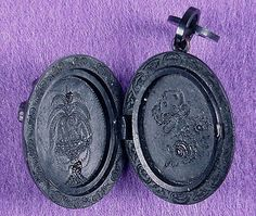 ANGELS GREET THE DAY ( Victorian Mourning Jewelry Locket ): This Victorian Mourning Locket (c 1870 - 1890) is molded of vulcanite, an early form of plastic patented in 1864 by Charles Goodyear (Yes, tires!)