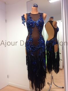 Mesh latin dress with intricate blue stoned designs and black fringe from Ajour Designs. Visit http://ballroomguide.com/comp/attire/lady.html for more info about competition attire.