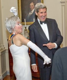 Boogie down: Rita Moreno has a little fun with U.S. Secretary of State John Kerry following the Artist's Dinner honoring the Kennedy Center Honorees - Moreno was the first Latina to win an Academy Award, for her performance as Anita in West Side Story