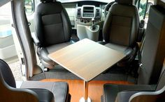 Sussex Campervans Paradise Twin LWB comfortably seat 4 round table.jpg
