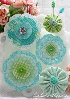 Fun Fabric Flowers! Could use as embellishments on a bulletin board or picture frame!