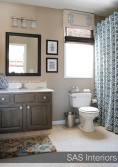 beige with dark brown and blue accent I like the shower curtain and window valance