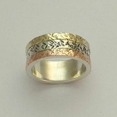Men's Wedding band - Sterling silver band with yellow and rose gold -  love of mine 2. $234.00, via Etsy.