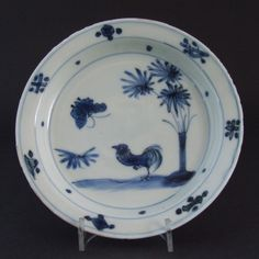 A Ming Dish Made for the Japanese Market, Tianqi or Chongzhen Period c.1620-1640. This Transitional Porcelain Dish Shows a Strutting Cockerel Looking up at a Large Butterfly in a Landscape with a Banana Plant.