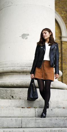 White sweater (tucked in), camel suede mini skirt, black tights, black oxfords, black leather moto jacket