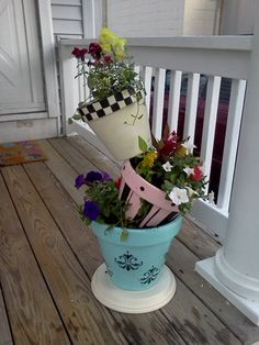 Oh sure, I just finish making a great tiered planter and now I find this one!  I love it.  Can I find room on my patio for this one next year?  from - Tiaras and Bowties: Our topsy turvy pot!