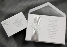 Ribbon Wedding Invitations by Social Graces, LLC  100 invitations for $239.90. We will help you word them. Social Graces, LLC located in Mendham, NJ 973-543-2145
