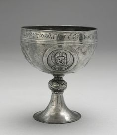 Chalice from the Beth Misona Treasure, c. 500-700, Byzantium, Syria or Constantinople, Silver,   The four objects form what is now called the Beth Misona Treasure, named for the village in Syria where they were made. Each of the three chalices bears a portrait bust of Christ, the Virgin, and Saints Peter and Paul. The Greek inscription along the rim of one of the chalices reads: The priest Kyriakos, son of Domnos [has presented this chalice] to Saint Sergios, under Zeno the priest.
