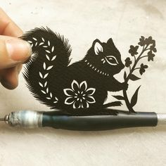 « Hello tiny #squirrel. #papercutting »