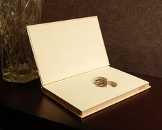 Pin this Ring Bearer Book for later! FAST & FREE SHIPPING TO USA! A ring bearer book is the perfect way to open a wonderful new chapter of your unique love story. There's a magnetic closure so your rings will journey safely down the aisle, (even when your book is upright).