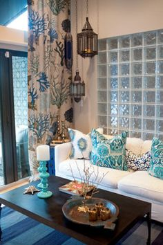 Why not add some beautiful inspiring curtain panels and add some punch colors to a quite room.  Love the idea of blocking the view from the front door into the home! Privacy.....