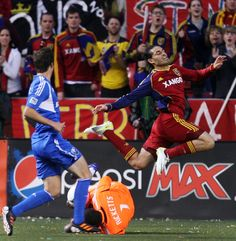 RSL's Fabian Espindola leaps over Montreal goal keeper Donovan Ricketts.