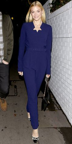 Jaime King wearing a Rachel Zoe Collection jumpsuit, the designer's chain-strap bag and cap-toe heels.