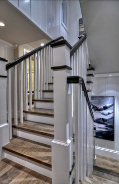 Stairway. Stairway Ideas. Detailed finished carpentry creates a wow factor on this square spiral stairway. White walls and spindles are compliments by wire brushed wood stairs and handrails. This stairway is truly a work of art.  #Stairway