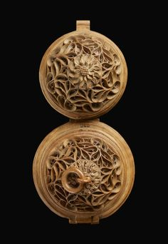 """Tiny object dating all the way back to 16th century Flanders. Measuring just a couple inches in diameter when closed, this awesomely ornate object is a """"prayer nut"""" or rosary bead, a very small and spherical boxwood carving that opens to reveal incredibly detailed relief carvings of biblical events.  Extraordinary objects such as this were prized possessions of the wealthy during the Middle Ages, carried around and used for private devotion. They were status symbols as much as symbols of…"""