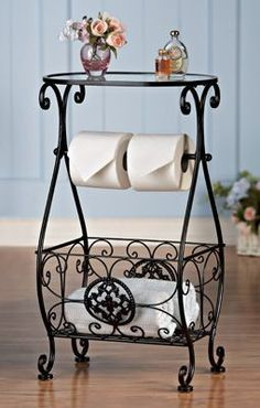 Bathroom Decor Glasstop Bathroom Storage Table Elegant bathroom table has a… Tissue Paper Roll, Wrought Iron Decor, Collections Etc, Iron Furniture, Bathroom Toilets, Bathrooms, Table Storage, Bathroom Storage, Bathroom Table