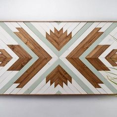 Perfect focal point for your wall or for a space that needs something special and unique to enliven it. Each piece is made exclusively with locally sourced Black Walnut, White Oak, and Douglas Fir. Comes in a variety of sizes Individually made to order Learn the process behind the art. Due to the custom handmade nature, lead time is 3-4 weeks. This item has a 7-day return policy.