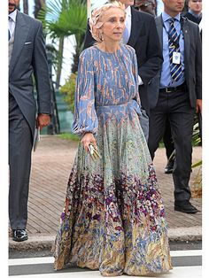 Franca Sozzani, editor-in-chief of Vogue Italia, took the floral trend to the next level by adding a flower headpiece to her colorful gown.