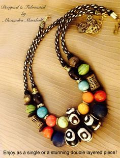 """""""Out of Africa"""" Two artisan crafted necklaces by Alexandra Marshall featuring bone, brass, multicolored howlite, paper, recycled glass, turquoise, & wood African Trade beads. 18"""" - 22"""" long, suspended from hand woven black, brown, & cream cords. $129. Ea. (top #N1089) and/or (bottom #N2089). Save money and order the pair for $194. Double click photo to order."""