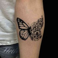 A cool-girl floral butterfly tattoo in black.