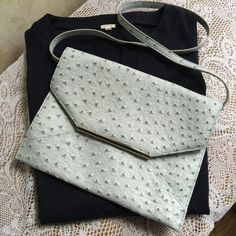 Merona ostrich clutch, pale blue Darling Mossimo clutch. Pale blue faux ostrich with a navy lining. This oversized envelope style purse is the perfect look and feel for spring. Big enough for every day, outings or to carry your iPad mini. Comes with a snap-on strap to convert to a shoulder bag. In like-new condition, used once. Merona Bags Clutches & Wristlets
