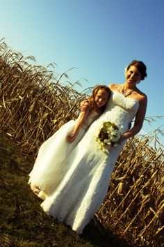 bride with flowergirl, country wedding, cornfield